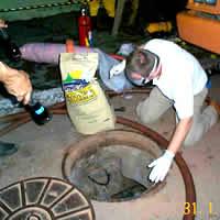 Aplicação de absorvente granulado para hidrocarbonetos de petróleo em rede subterrânea de cabos telefônicos