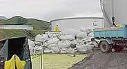 Transporte por caminhão e armazenamento temporário